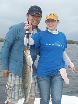 Cute couple with Spotted Seatrout caught in Mosquito Lagoon