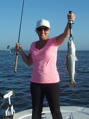 Lady with Trout caught in Mosquito Lagoon