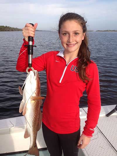 Young girl with Redfish caught near New Smyrna